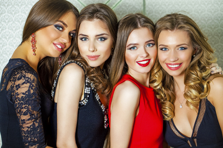 blond hair: Close up portrait of four beautiful glamorous young women in studio Stock Photo