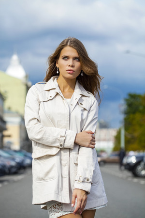 greatcoat: Portrait close up of young beautiful woman in white dress Stock Photo