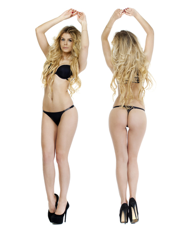 femme en sous vetements: Portrait de femme blonde sexy en sous-v�tements noir sur blanc isol� Banque d'images