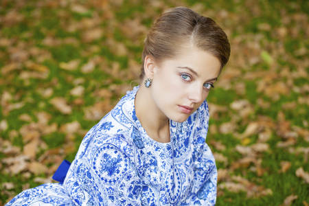one eyed: Close up portrait of a beautiful young blonde woman, outdoors Stock Photo