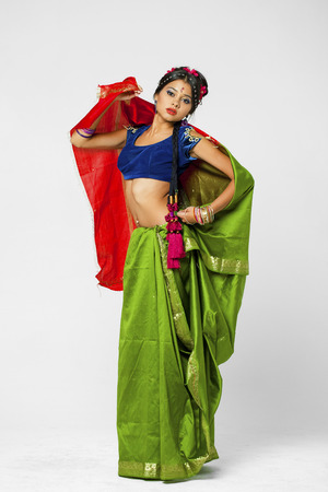 indian wedding: Young beautiful brunette woman in indian green dress Stock Photo