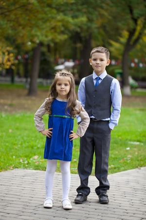 little girl child: Portrait of a pretty Brother and sister in autumn park