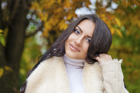 clothed: Facial portrait of a beautiful arab woman warmly clothed autumn outdoor Stock Photo