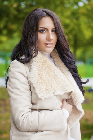 arab glamour: Facial portrait of a beautiful arab woman warmly clothed autumn outdoor Stock Photo