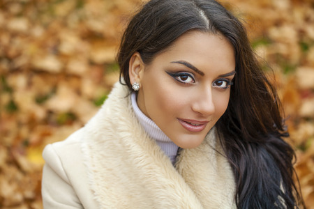 warmly: Facial portrait of a beautiful arab woman warmly clothed autumn outdoor Stock Photo