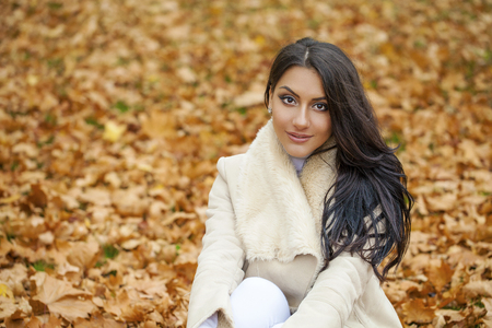 Facial portrait of a beautiful arab woman warmly clothed autumn outdoor Standard-Bild