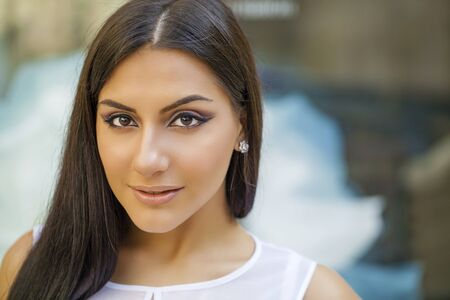 middle eastern ethnicity: Oriental style. Sensual arabic woman model. Beautiful clean skin, saturated makeup. Bright eye make-up and dark eyeliner