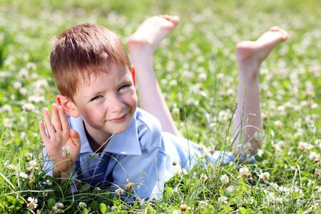 5 years old: 5 years old child lying on the grass.