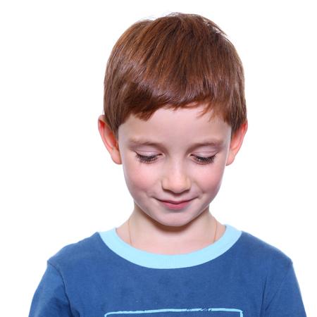 modesty: little boy looking down