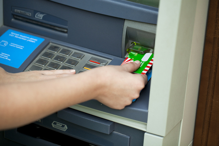 automatic teller machine bank: Female arms Take cash from the ATM, close up