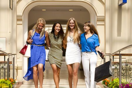 casual fashion: Group of happy smiling women shopping