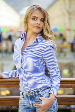 striped shirt: Attractive blonde girl, makeup female face indoor, Portrait of a beautiful blonde in a blue striped shirt