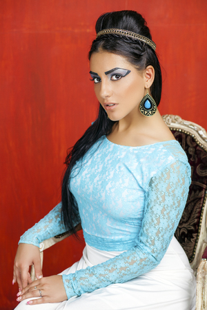 egyptian woman: Beautiful egyptian young woman, fashion portrait over red wall background