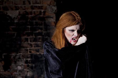 cloak: Terrible vampire woman in a red cloak