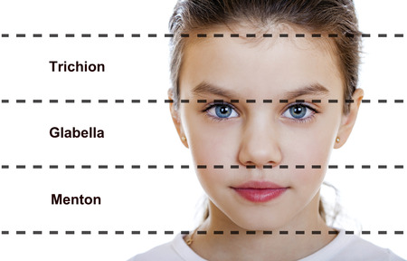 ideal: The ideal beauty. Symmetric of the female face of a little girl, isolated on white background