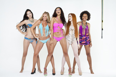 standing together: Five young women in bikini