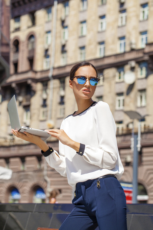 decides: Young Beautiful business woman reading notepad Stock Photo