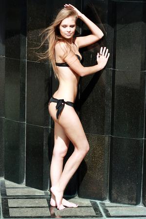black bikini: Sexy young blonde woman in black bikini
