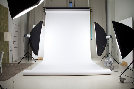 studio photography: Empty photo studio with lighting equipment