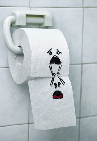felt tip pen: A roll of toilet paper and felt tip pen drawn funny faces Stock Photo
