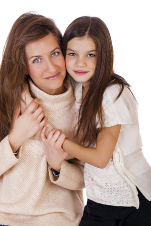 ten year old: Close up portrait of a beautiful ten year old little girl and happy mother, isolated on white background Stock Photo