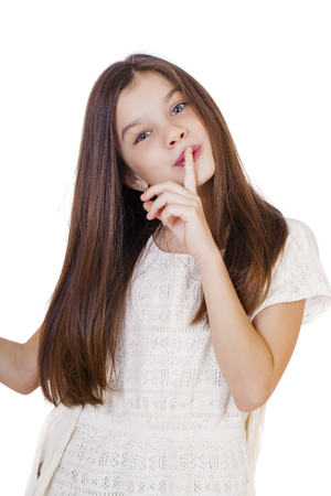 10 fingers: Young beautiful Little girl  has put forefinger to lips as sign of silence Stock Photo