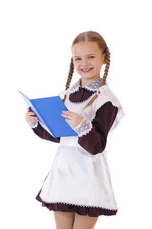 little blond school girl with blue book portrait isolated on white background