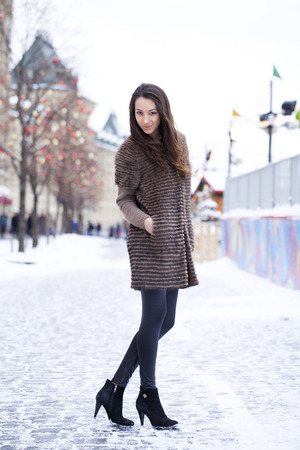 red square: Portrait in full growth of a beautiful stylish young woman on the background Red Square, Moscow Kremlin, Russia