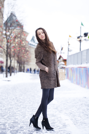 red square moscow: Portrait in full growth of a beautiful stylish young woman on the background Red Square, Moscow Kremlin, Russia