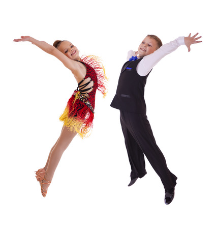 duet: Young dancers jumping in the studio, isolated on white