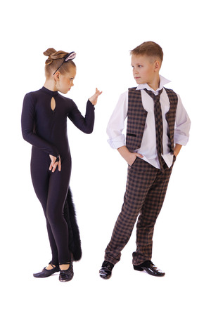 8 10 years: Dancing little girl dressed as a cat and a boy in a plaid vest, isolated on white background