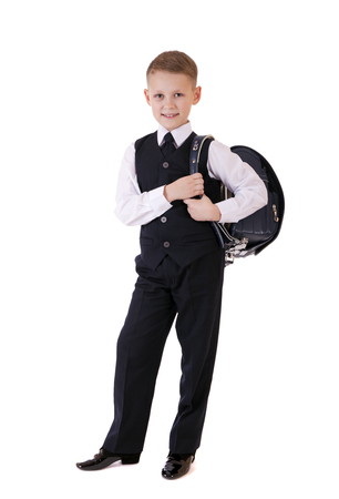 7 9 years: Full length portrait of a boy in a suit standing with schoolbag. Fashion kids. Education. Isolated over white background
