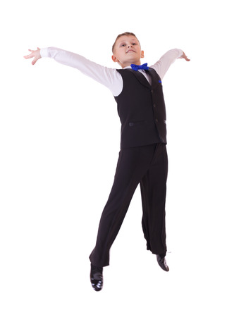 8 10 years: Happy little boy jumping in the studio, isolated on white background