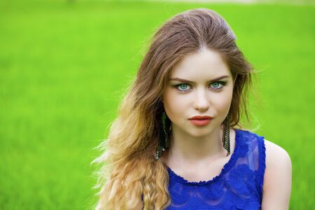 Close up Portrait, Young beautiful blonde woman posing outdoors in summer green park Stock Photo