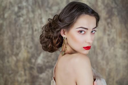 desires 25: Beauty portrait of young attractive woman on dark studio wall Stock Photo