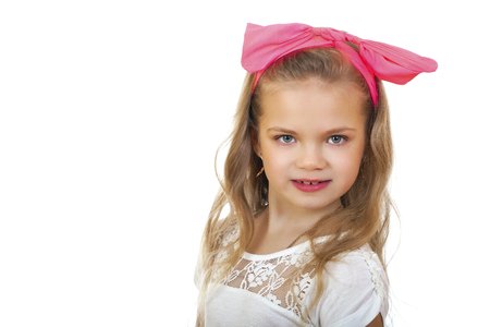 glamour makeup: Portrait of a little girl with a red bow on her head, studio on white background Stock Photo
