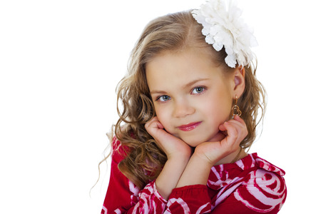 charming girl: Portrait of a charming little girl looking at camera, isolated on white background