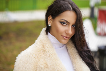 middle eastern ethnicity: Oriental style. Sensual arabic woman model. Beautiful young girl in fur coat