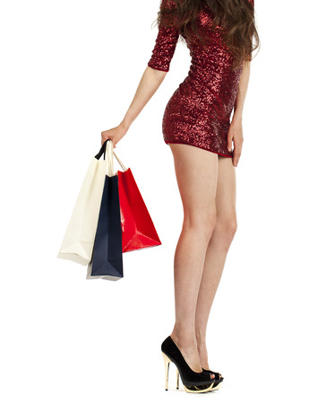 personal shopper: Shopping. Sexy female legs and color bags, isolated on white background