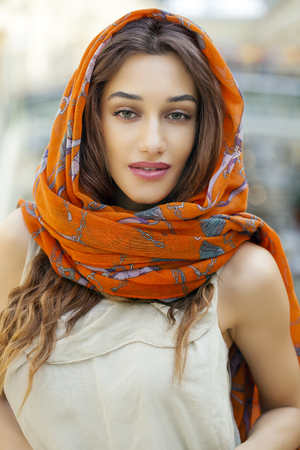 identidad cultural: Close up portrait of a muslim young woman wearing a head scarf, indoor