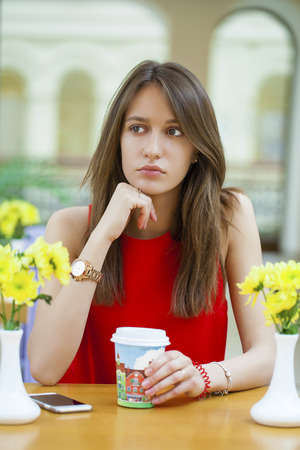 gorgeous girl: Young beautiful brunette girl sitting in a coffee shop