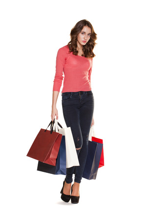 Shopping. Young casual brunette woman portrait isolated on white background