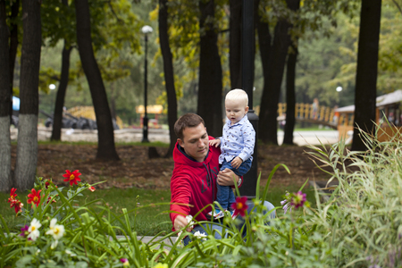 two year old: Young Father with two year old son in summer park Stock Photo