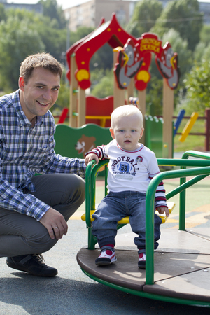 two year old: Young Father with two year old son on the playground Stock Photo