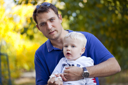 two year: Young Father with two year old son in summer park Stock Photo
