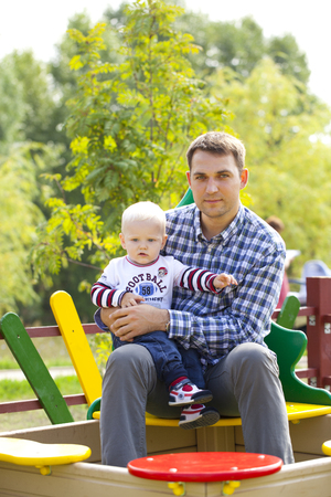 two year: Young Father with two year old son on the playground Stock Photo