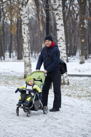 Young father with two year old son in winter park Stock Photo