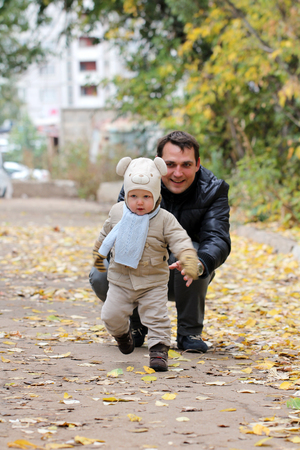 two year: Young Father with two year old son in autumn park