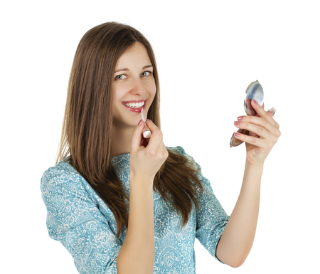 cheek: young beautiful woman applying powder on cheek with brush - isolated