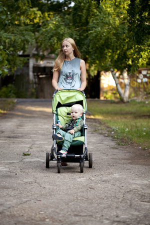 two year old: Young mother with two year old son in summer park
